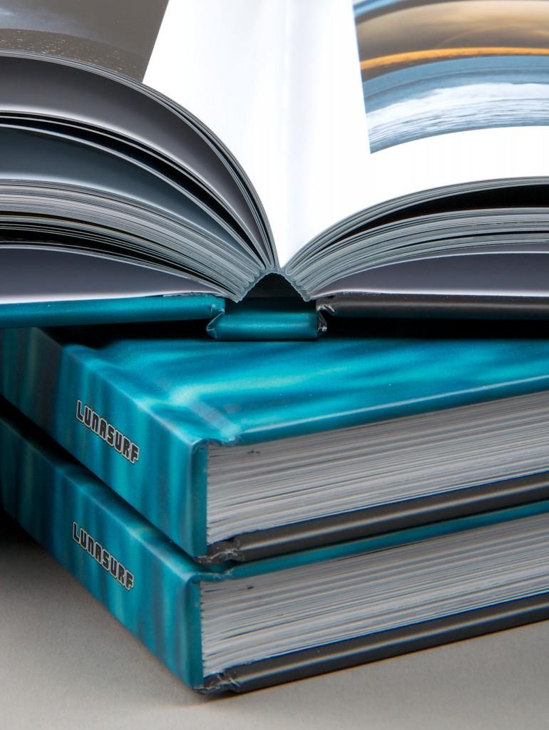 A printed hardback book promotes property sales